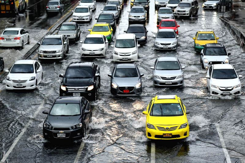 BANGKOK, May 27, 2017 - Vehicles are seen on a flooded road in downtown Bangkok, Thailand, May 27, 2017. Successive downpours have left many roads in Bangkok flooded, with some areas witnessing the ...
