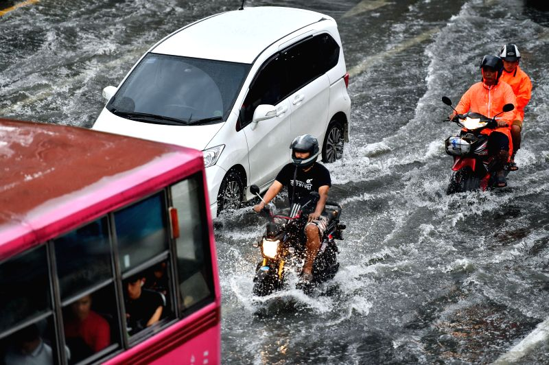 BANGKOK, May 27, 2017 - Vehicles make their way through a flooded road in downtown Bangkok, Thailand, May 27, 2017. Successive downpours have left many roads in Bangkok flooded, with some areas ...