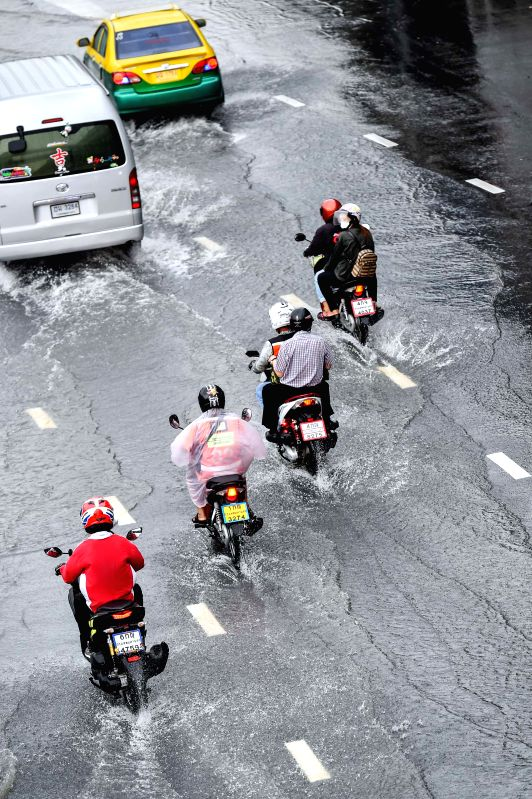 BANGKOK, May 27, 2017 - Vehicles make their way on a flooded road in downtown Bangkok, Thailand, May 27, 2017. Successive downpours have left many roads in Bangkok flooded, with some areas witnessing ...