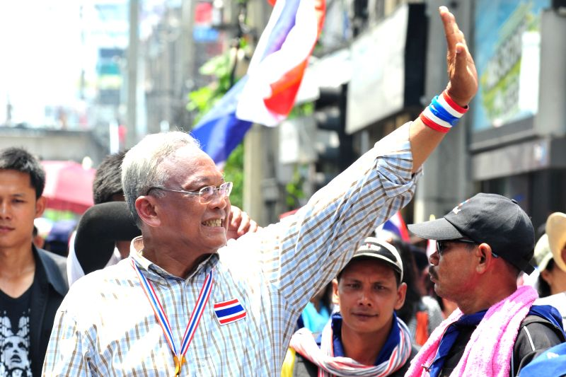 Anti-government protest leader Suthep Thaugsuban greets supporters during a rally on main street in Bangkok, Thailand, May 8, 2014.