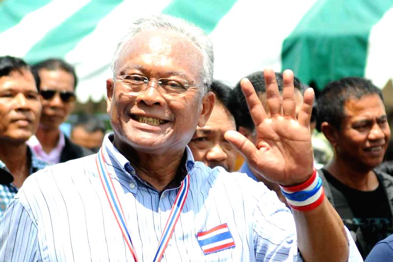 Anti-government protest leader Suthep Thaugsuban (front) gestures during a rally in Bangkok, Thailand, May 9, 2014. Thailand's anti-government protesters on Friday ...