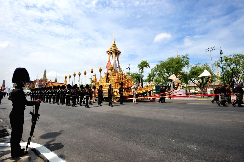 BANGKOK, Oct. 7, 2017 - Soldiers and honour guards escort the royal chariot which will be used to carry the urn of the late Thai King Bhumibol Adulyadej during a rehearsal for the King's funeral near ...