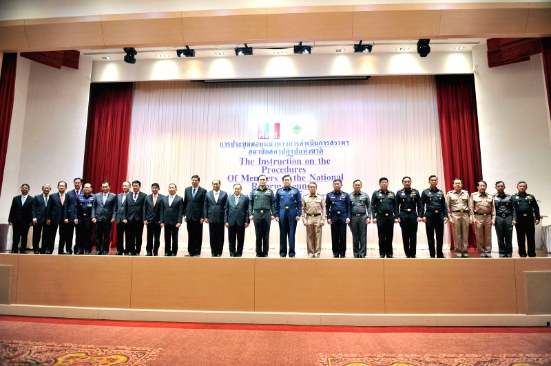 Thai military junta head and new Prime Minister General Prayuth Chan-ocha (12th R) poses for photos during a meeting of the instruction on the procedures of members - General Prayuth Chan