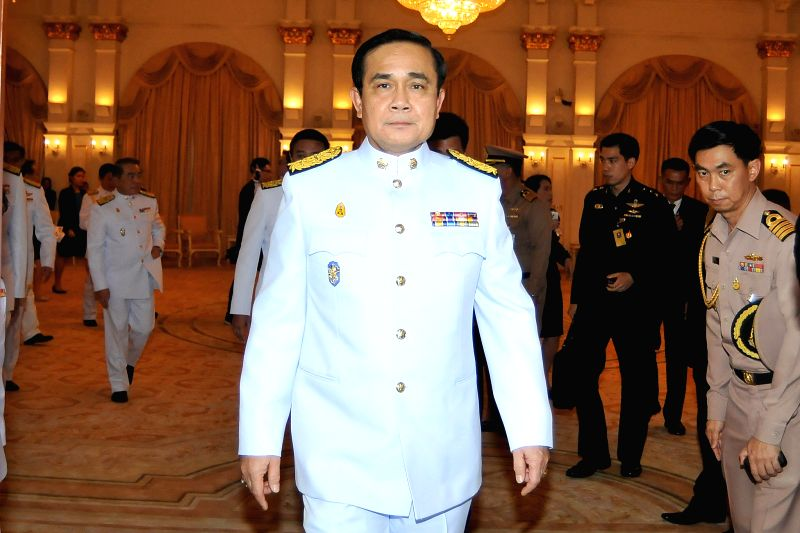 Thai Prime Minister Gen. Prayuth Chan-ocha (Front) walks at the government house in Bangkok, Thailand, Sept. 4, 2014. Thail Prime Minister Gen. Prayuth Chan-ocha ... - Gen