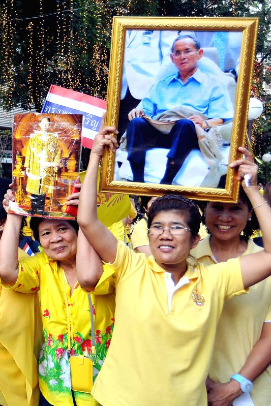 Thai people participate in the celebration of Thai King Bhumibol Adulyadej's 87th birthday in Bangkok, Thailand, Dec. 5, 2014. Thai King Bhumibol Adulyadej on Friday cancelled a ...