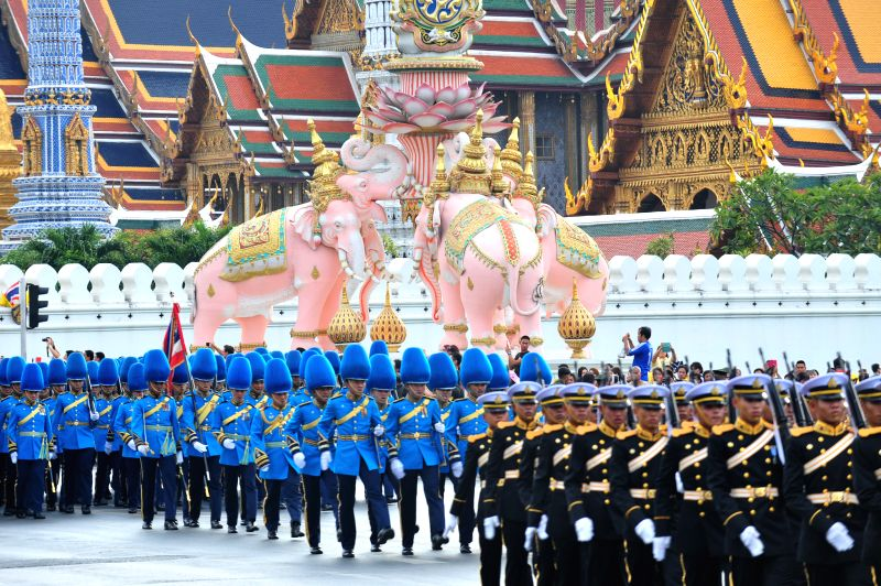 : Thai soldiers attend a parade as part of the King Bhumibol Adulyadej's upcoming 87th birthday celebration outside the Grand Palace in Bangkok, Thailand, Dec. 2, 2014. Thai King Bhumibol ...