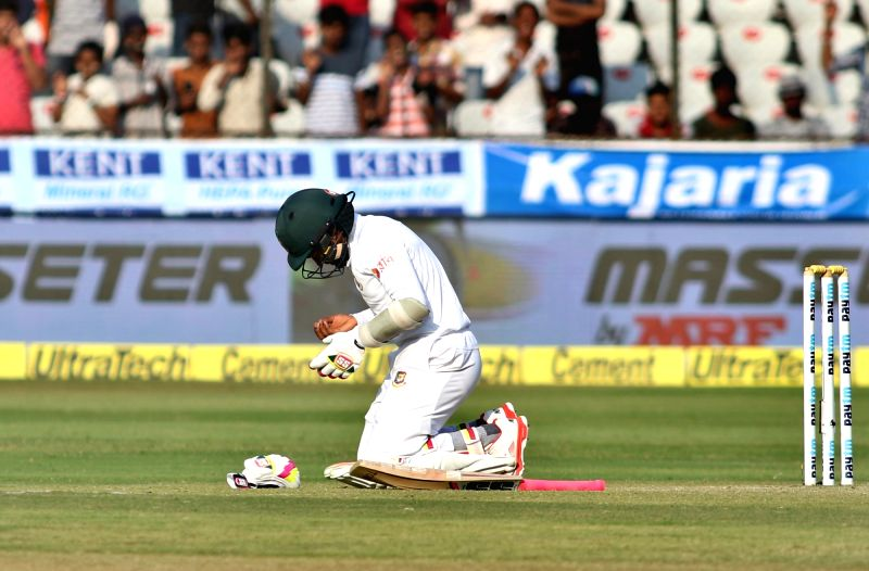 Bangladesh captain Mushfiqur Rahim checks his hand after being hit on a delivery during the test match between India and Bangladesh in Hyderabad on Feb. 11, 2017. - Mushfiqur Rahim