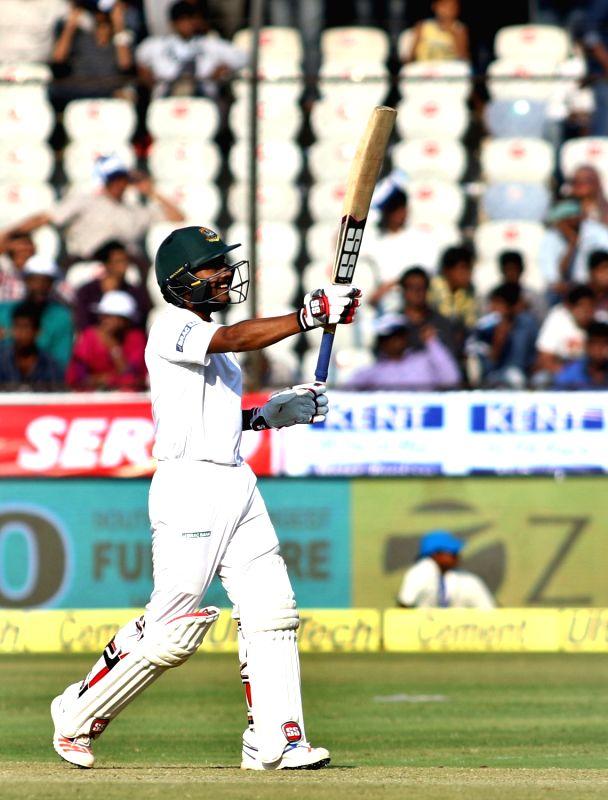Bangladesh cricketer Mehedi Hasan raises his bat after scoring 50 runs during the test match between India and Bangladesh in Hyderabad on Feb. 11, 2017.
