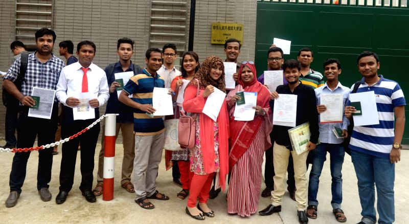 BANGLADESH, July 20, 2016 - Bangladeshi scholarship winners pose for a group photo after receiving scholarship document paper from Chinese government in front of the Chinese Embassy in Dhaka, ...