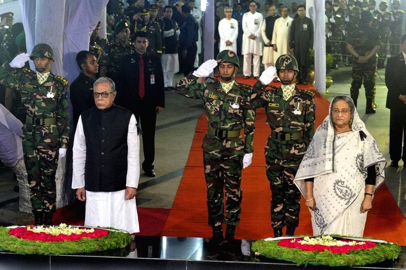 Bangladesh President Md Abdul Hamid and Bangladesh Prime Minister Sheikh Hasina lay wreaths at the mural of Bangabandhu Sheikh Mujibur Rahman at Dhanmondi 32 on the National Mourning Day, marking the - Sheikh Hasina