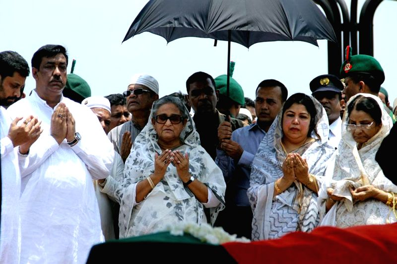 Bangladesh Prime Minister Sheikh Hasina pays respect to late MP Nasim Osman at the South Plaza of Bangladeshi Parliament in Dhaka on May 2, 2014.