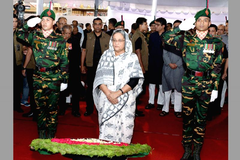 Bangladesh Prime Minister Sheikh Hasina pays tribute to the victims of `Aug 21 grenade attacks` at Bangabandhu Avenue in Dhaka, Bangladesh on Aug 21, 2014. - Sheikh Hasina