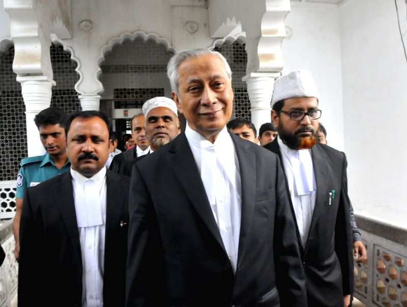 Bangladesh's Attorney General Mahbubey Alam (Front) comes out of the court in Dhaka, Bangladesh, Nov. 18, 2015. Bangladesh's highest court has rejected appeals from ...
