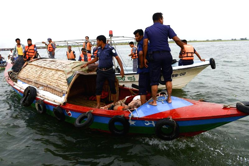 Bangladeshi Coast Guards during rescue operation launched to save the passengers of MV Miraj-4 which capsized in Meghna river near Daulatdia in a storm in Munshiganj of Bangladesh on May 15, 2014.