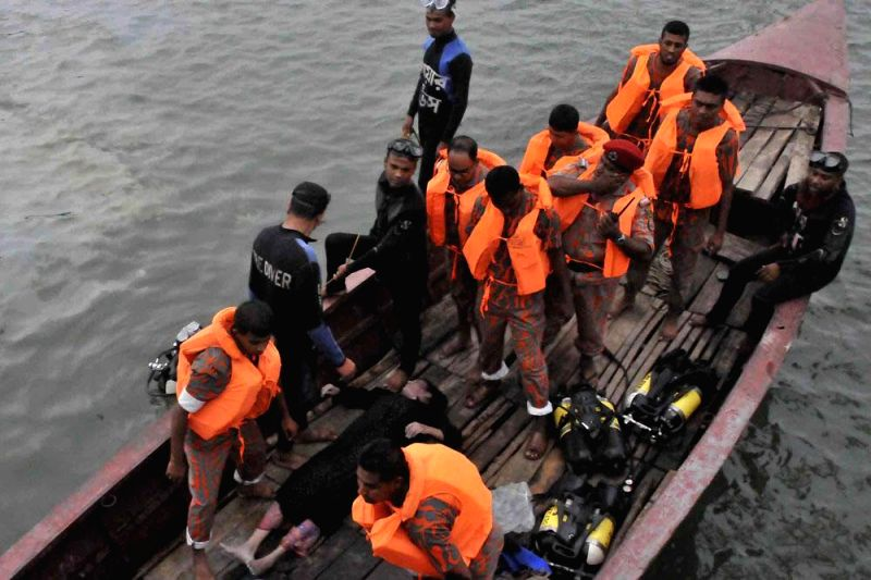 Bangladeshi Coast Guards during rescue operation launched to save the passengers of MV Miraj-4 which capsized in Meghna river near Daulatdia in a storm in Munshiganj of Bangladesh on 15th May,  on ...