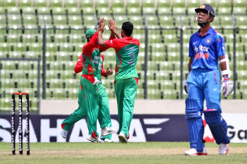 Bangladeshi cricketer Al-Amin Hossain celebrates fall of Ajinkya Rahane's wicket during the third One Day International (ODI) match between India and Bangladesh at the Sher-e-Bangla National Cricket .