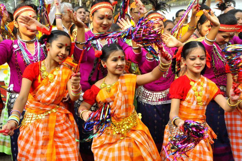 Bangladeshi people attend a colorful rally to celebrate a harvest festival at Fine Arts Faculty of Dhaka University in Dhaka, Bangladesh, Nov. 15, 2015. Bangladeshi ...
