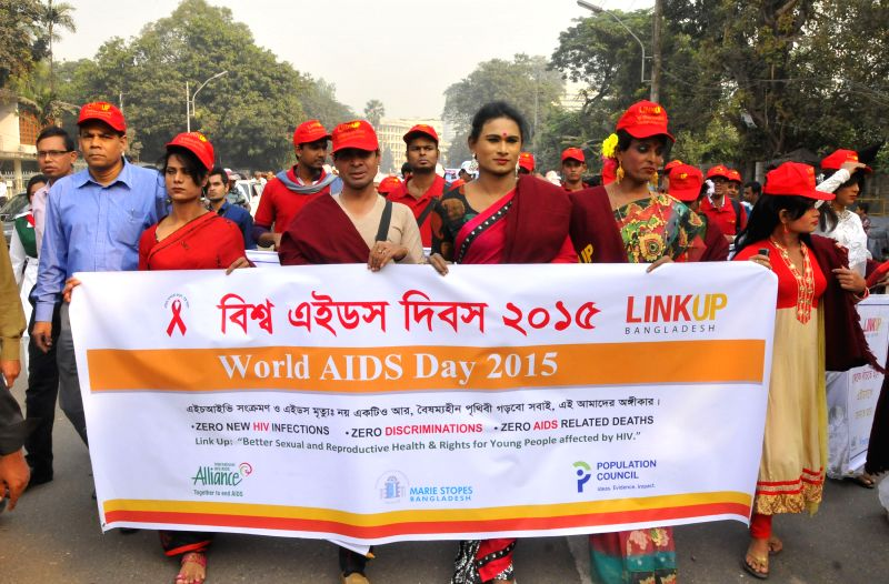 Bangladeshi people participate in a rally to mark the World AIDS Day in Dhaka, Bangladesh, Dec. 1, 2015. The International World AIDS Day which falls on Dec. 1 is ...