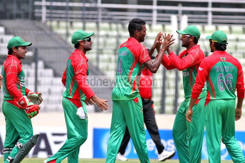 Bangladeshi players celebrate fall of Ajinkya Rahane's wicket during the third One Day International (ODI) match between India and Bangladesh at the Sher-e-Bangla National Cricket Stadium in Dhaka, ..