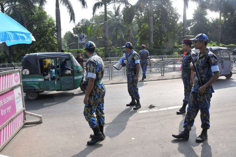 Bangladeshi policemen check a vehicle at a checkpoint in Dhaka, Bangladesh, Oct. 27, 2015. Commissioner of Dhaka Metropolitan Police (DMP) Asaduzzaman Mia said on ...