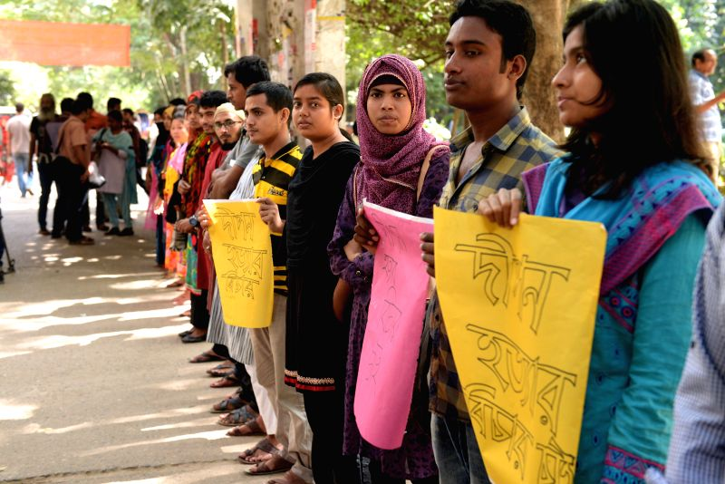 Bangladeshi students form a human chain protesting against the killing of Bangladeshi publisher Faisal Arefin Dipan, who was murdered in an attack by suspected ...
