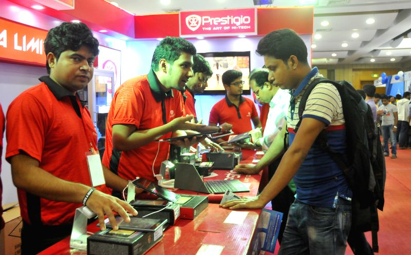 Bangladeshi visitors look at laptops during a laptop fair at Bangabandhu International Conference Centre in Dhaka, Bangladesh, Nov. 13, 2015. Bangladesh largest ...