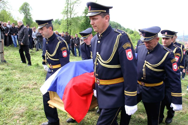 People take part in a funeral of the policeman who was killed in a terrorist attack on April 27 in Zvornik, Bosnia and Herzegovina, on April 29, 2015. One ...
