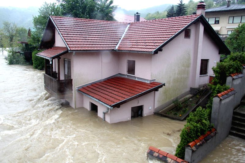 A  residence building is surrounded by flood water in Banja Luka, capital of Republika Srpska, an entity of Bosnia and Herzegovina on May 16, 2014. Hundreds of ...