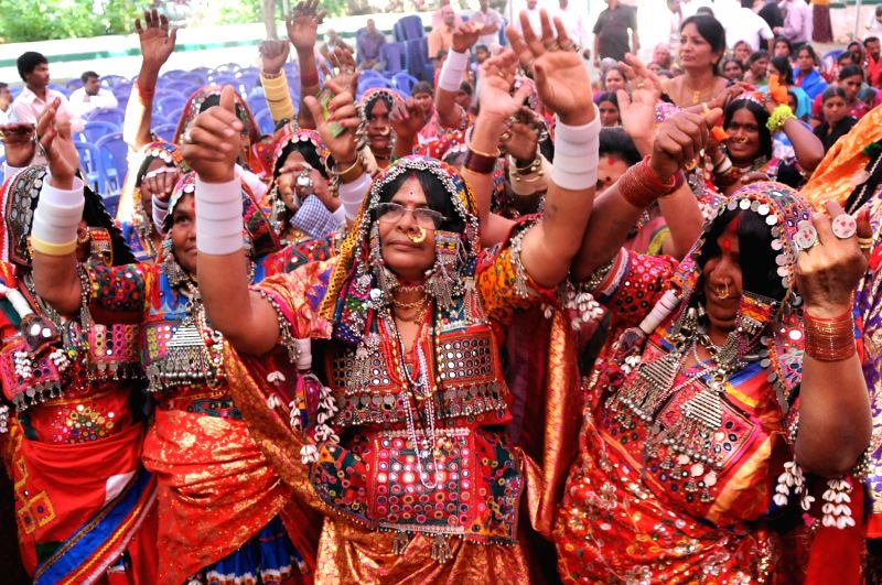 Banjara women perform their traditional dance during JD(S) state level ...