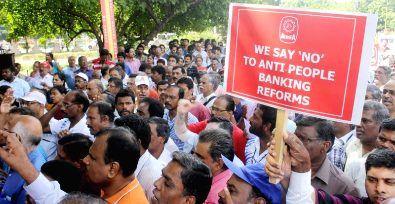 Bank employees affiliated to United Forum of Bank Unions (UFBU) stage a demonstration to protest against central government's policies for the banking sector, in Chennai on July 29, 2016. ...