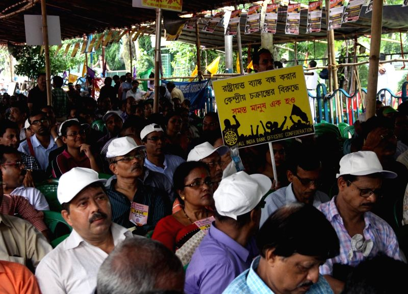 Bank employees stage a  demonstration against the Central Government's bank poloicies, in Kolkata on July 28, 2018.