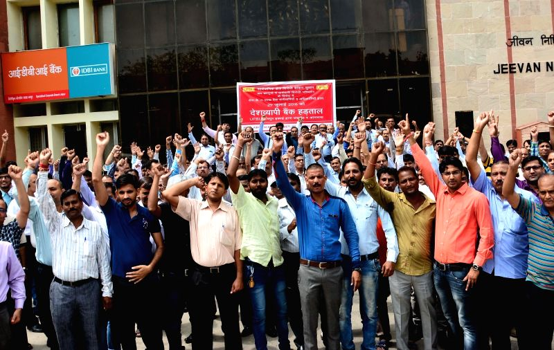 Bank employees stage a demonstration to protest against central government's policies for the banking sector, in Jaipur, on July 29, 2016. Banking operations across the country were hit as ...