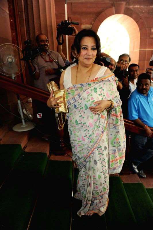 Bankura MP Moon Moon Sen arrives at the Parliament where Rail Budget 2014-15 is set to be presented in New Delhi on July 6, 2014.