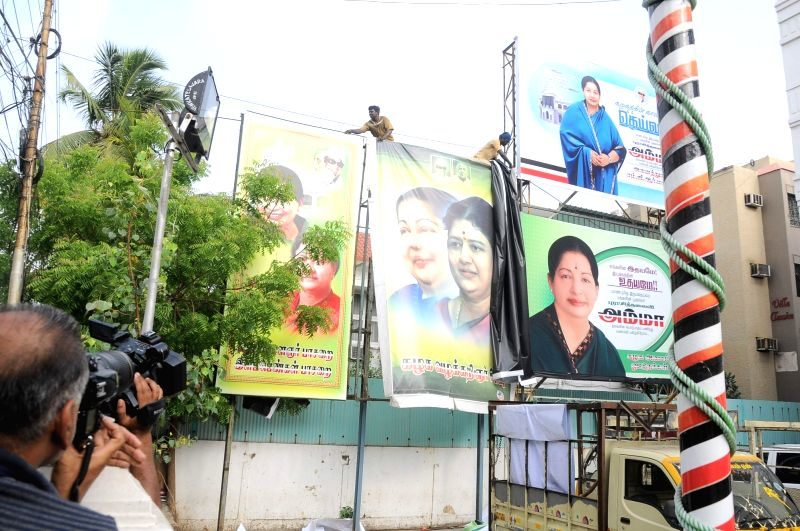 Banners having pictures of VK Sasikala being removed from AIADMK headquarters in Chennai on April 26, 2017.