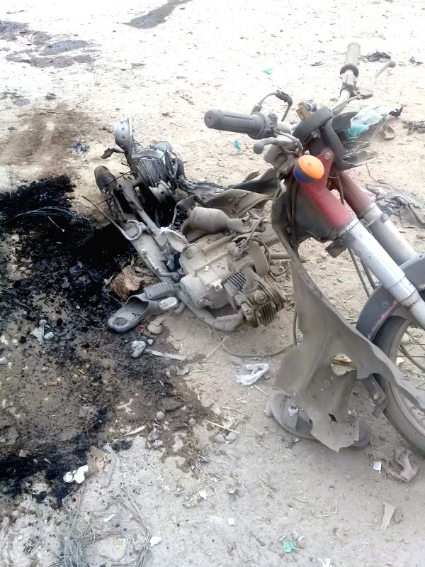 BANNU, July 13, 2018 - A damaged motorcycle is seen at the blast site in northwest Pakistan's Bannu on July 13, 2018. At least four people were killed and 24 others injured when a blast hit a convoy ...