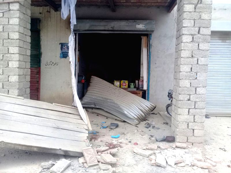 BANNU, July 13, 2018 - A damaged shop is seen at the blast site in northwest Pakistan's Bannu on July 13, 2018. At least four people were killed and 24 others injured when a blast hit a convoy of a ...
