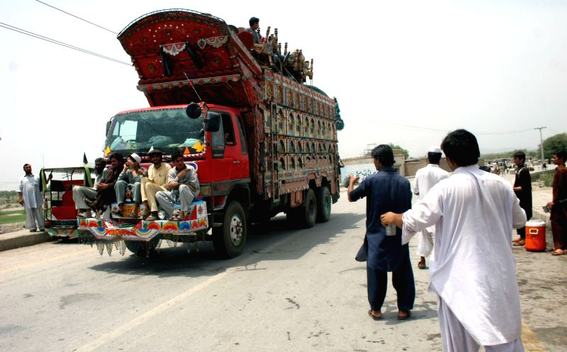 Pakistani civilians, fleeing due to a military operation in North Waziristan tribal region, arrive in northwest Pakistan's Bannu, June 19, 2014. Over 50,000 had fled .