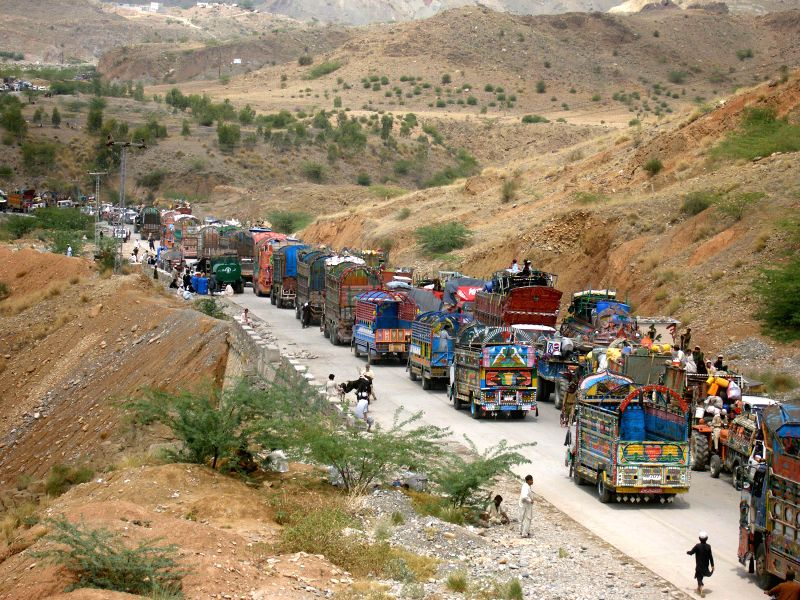 Vehicles line up at a security checkpoint as they arrive in northwest Pakistan's Bannu on June 19, 2014. Civilians are streaming out of a Pakistani tribal area in a ..