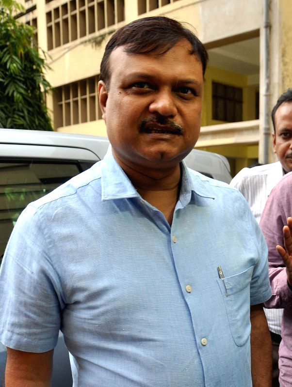 Bapi Karim, the former aide of West Bengal Transport Minister and Trinamool Congress leader Madan Mitra, arrives to appear before CBI in connection with multi-crore rupee Saradha chit fund scam in ...