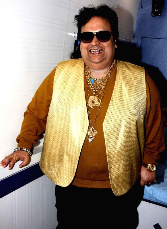 Bappi Lahiri during Dahi Handi festival at Politician Sanjay Nirupam`s Dahi Handi in Mumbai on August 29, 2013.