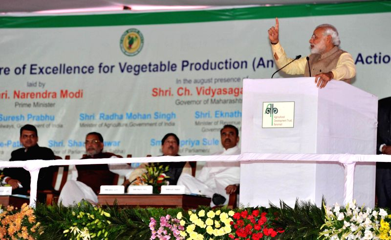 Prime Minister Narendra Modi addresses a Farmers; Rally, after the Foundation Stone laying Ceremony of the Centre of Excellence for Vegetable Development, in Baramati, Maharashtra on Feb ... - Narendra Modi