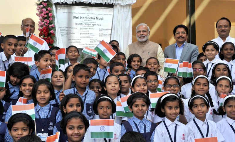 Prime Minister Narendra Modi with children at the inauguration of a new CBSE building, at Vidya Pratisthan Campus, in Baramati, Maharashtra on Feb 14, 2015. Also seen  Maharashtra Governor . - Narendra Modi and C. Vidyasagar Rao