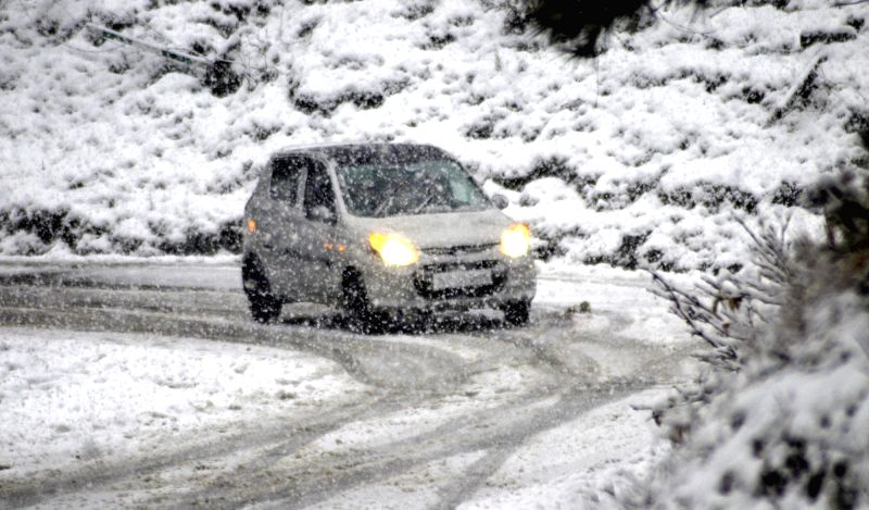 Baramulla: A four-wheeler wades through a road during snowfall in Jammu and Kashmir's Baramulla on Nov 23, 2020. (Photo: IANS)