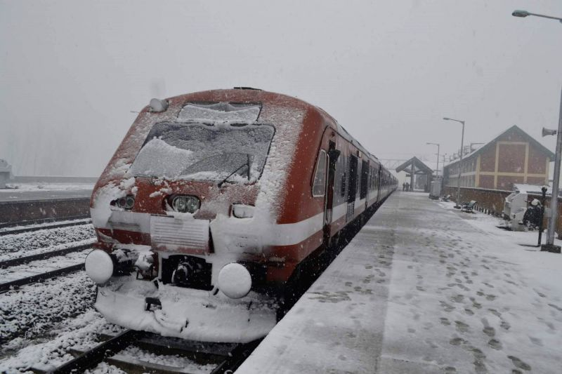 A passenger train covered with snow after heavy snowfall in Baramulla on Feb. 3, 2015.