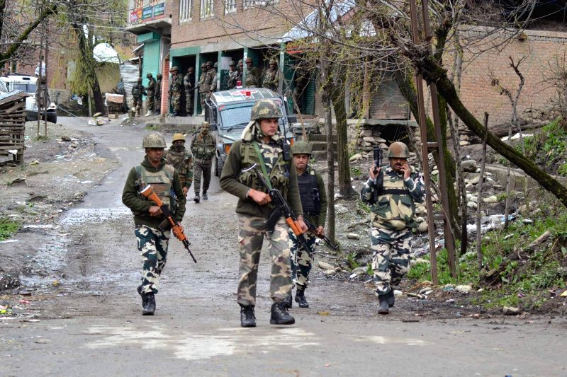 Security personnel at the spot of the gunbattle between guerrillas and security forces where a police official was killed and two soldiers were injured in Kashmir's Baramulla district on ...