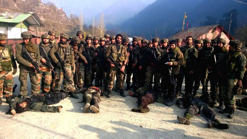 Soldiers present the bodies of the militants who mounted an audacious attack on Indian Army's Field Ordinance Camp at Mohra near the border town of Uri in Baramulla district of Jammu and ..