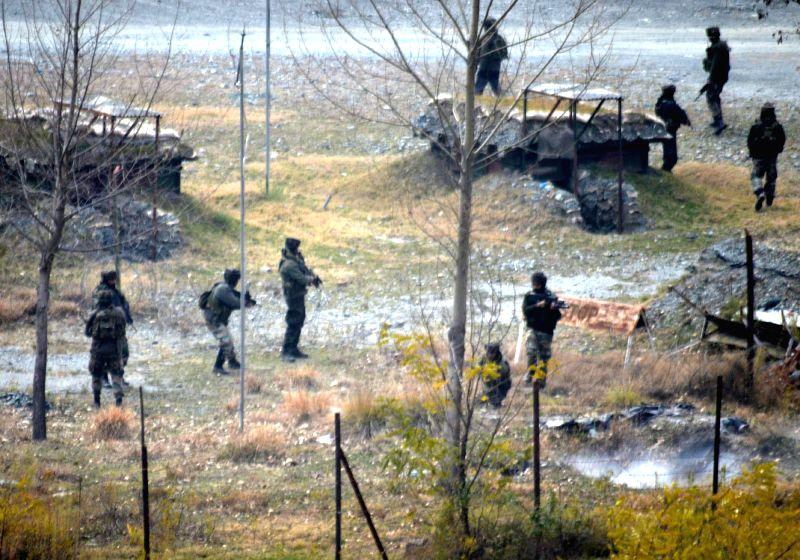 Soldiers take position during an encounter with heavily-armed militants who  mounted an audacious attack on Indian Army's Field Ordinance Camp at Mohra near the border town of Uri in ...