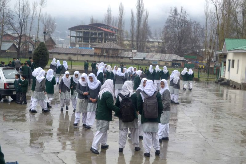 Students head for school as winter vacation end in Baramulla of Jammu and Kashmir on March 16, 2015.