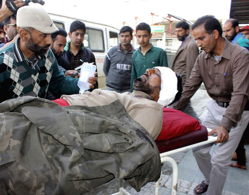 The policeman who was critically injured after being shot at by guerrillas in Jammu and Kashmir's Baramulla being wheeled into a hospital for treatment on April 6, 2015.
