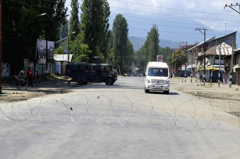 Barbed wires laid on a streets of Baramulla as authorities impose curfew in Kashmir valley on July 29, 2016.